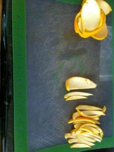 Slicing orange peels.