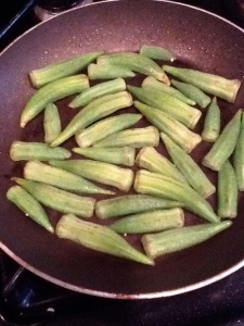 Cooking the okra.
